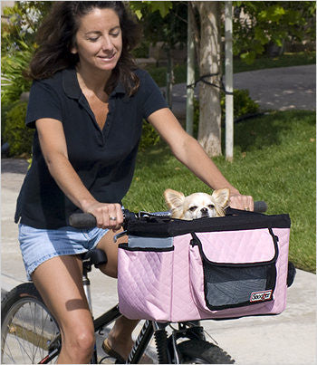 Chihuahua riding in pink dog basket
