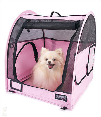 Pomeranian sitting in SturdiShelter Pop Up crate