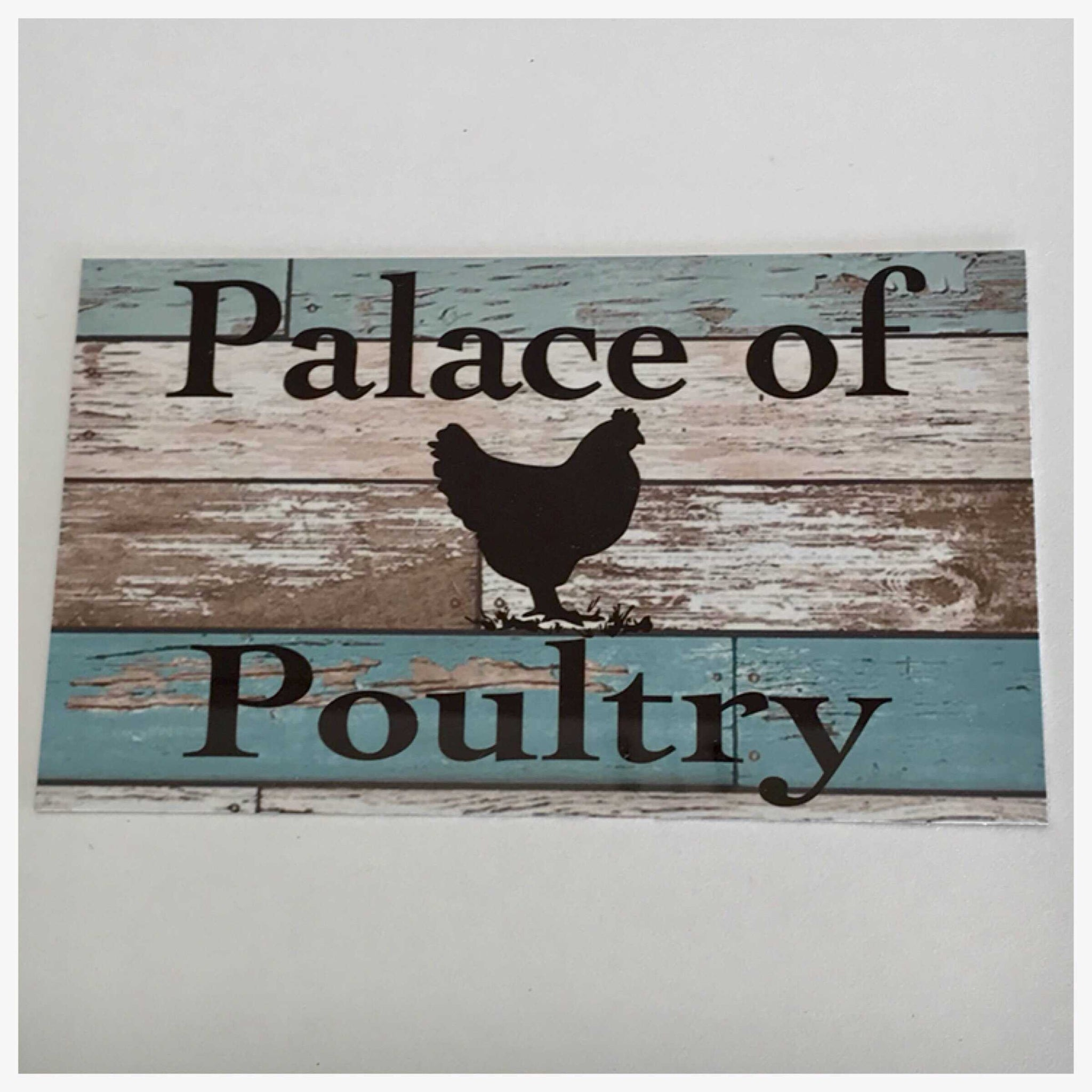 Palace Of Poultry Blue Sign