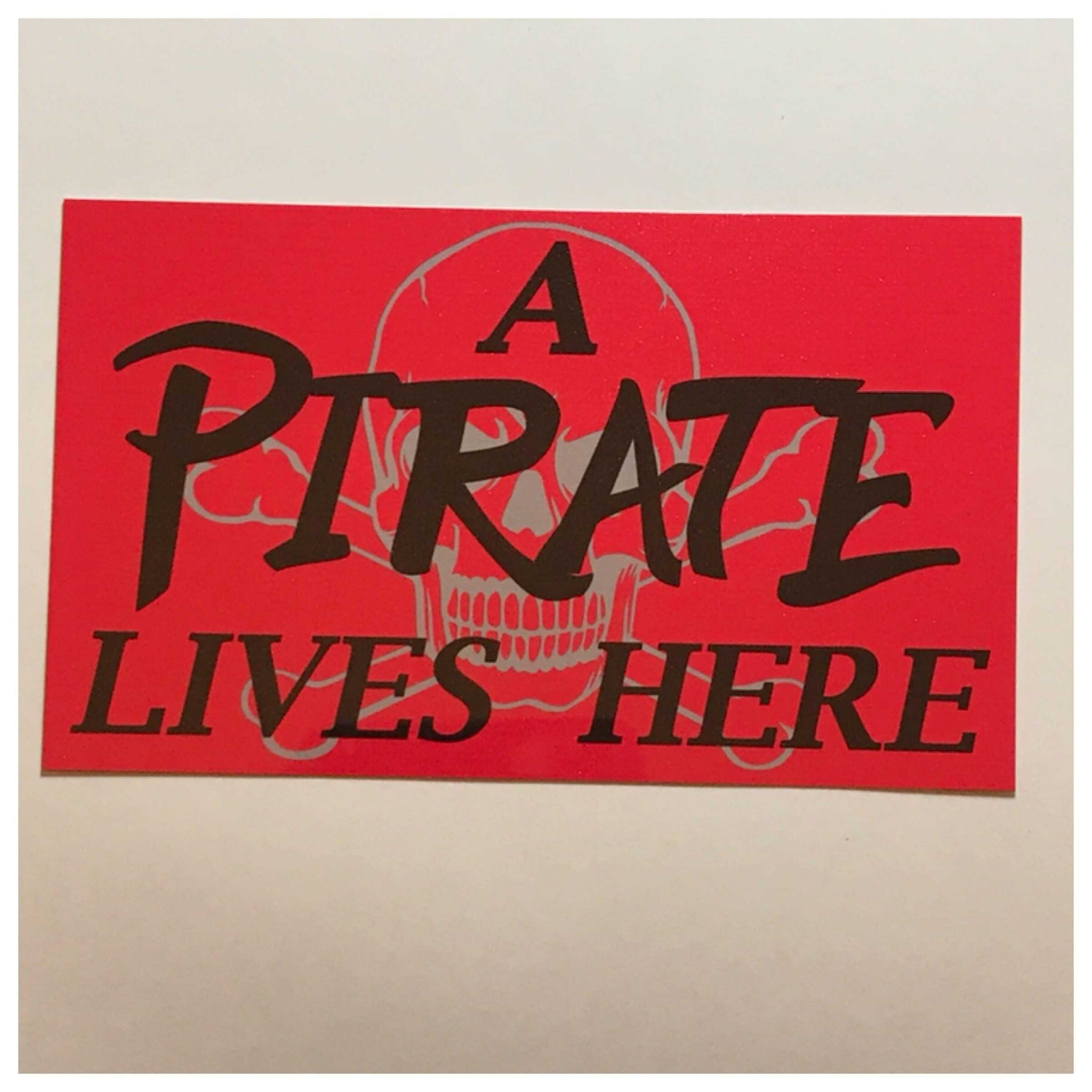 A Pirate Lives Here Red Sign