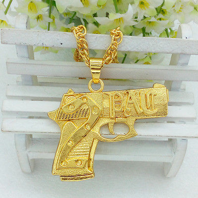 Gold gun necklace