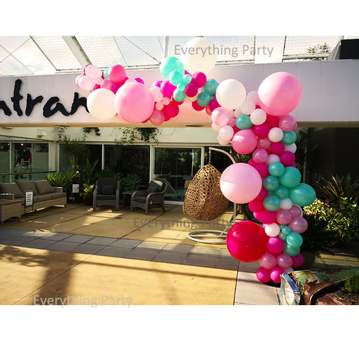 pink and mint balloon arch
