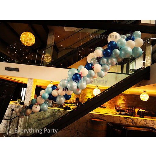 balloon garland on stairs, balloon arch on stairs