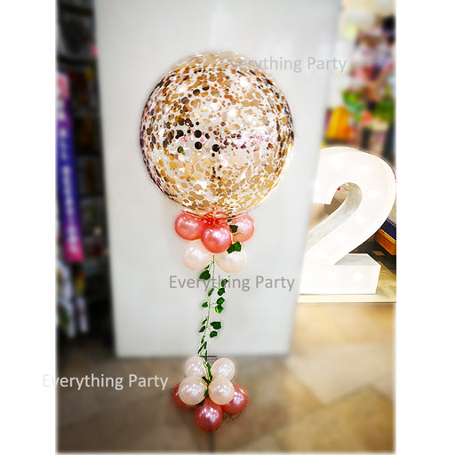 rose gold confetti balloon with leaves