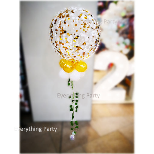 gold confetti balloon with leaves