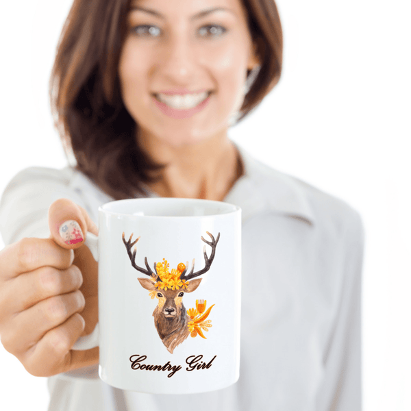 woman holding deer coffee mug