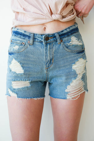 [shop name], in the clear destroyed denim shorts