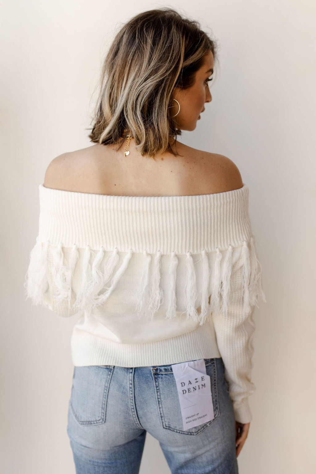 off the shoulder, on the fringe