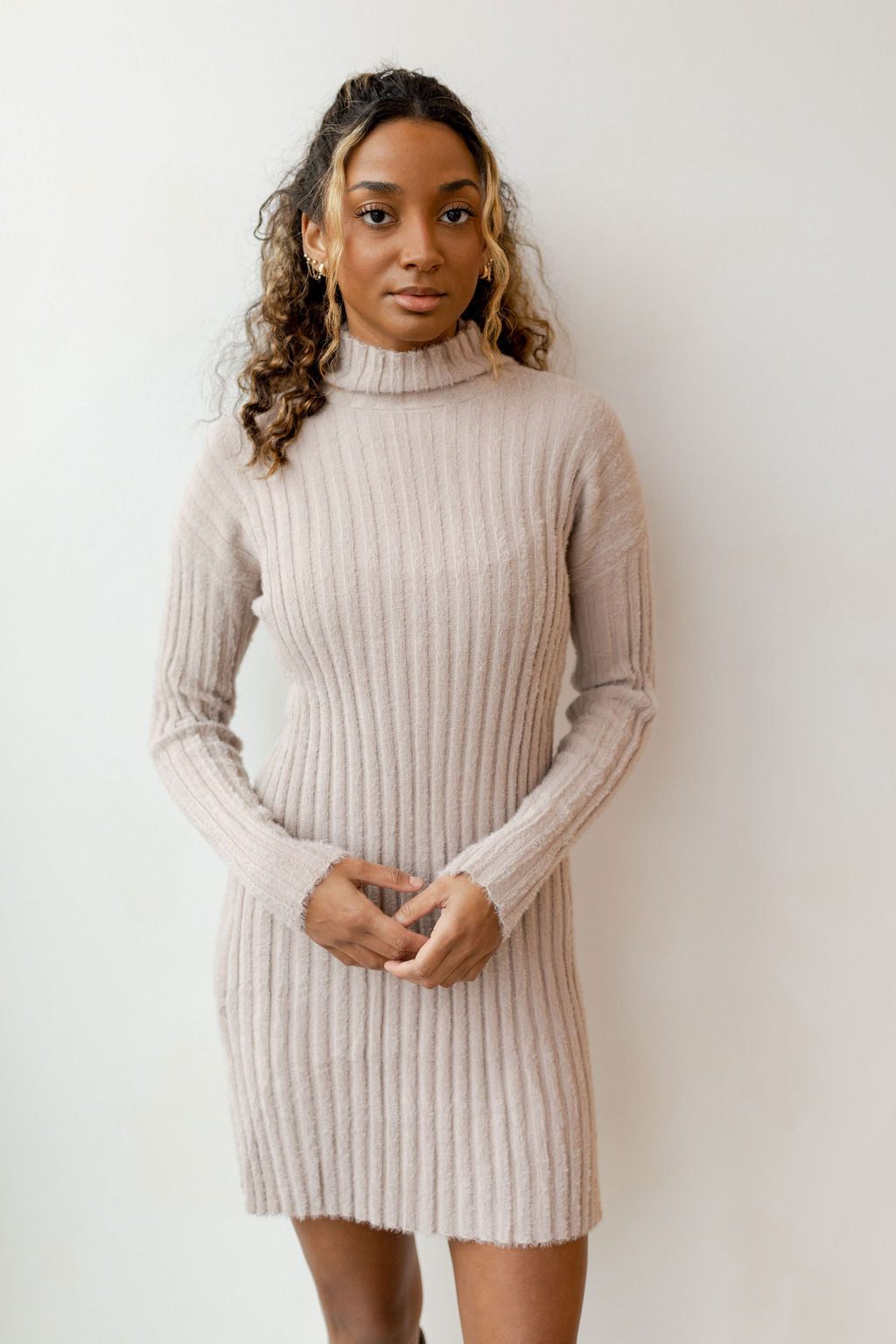 blushing turtleneck sweater dress