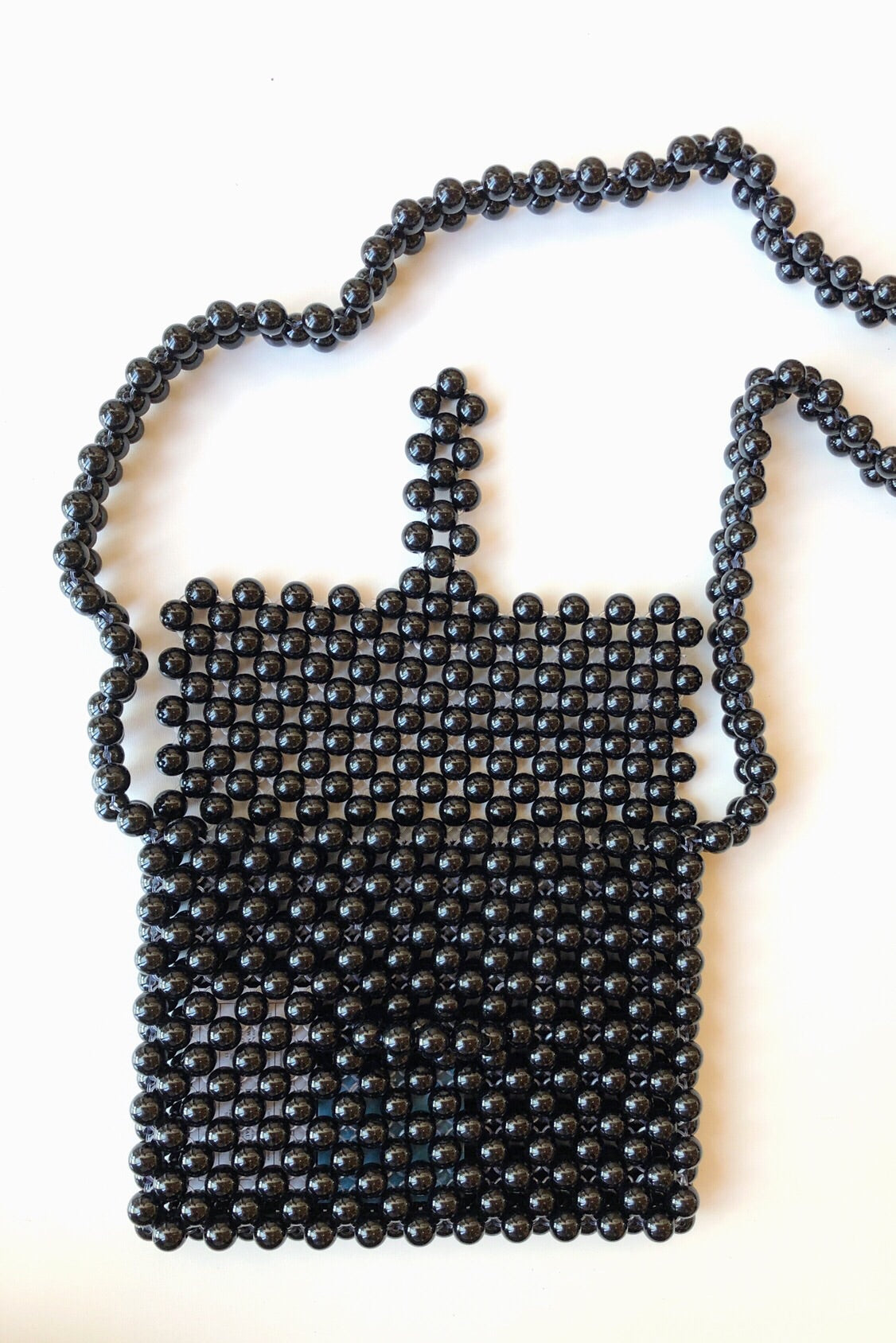 mode, believe it round beaded bag