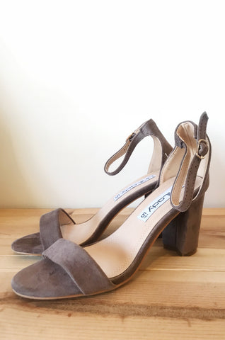 triple threat buckle heel