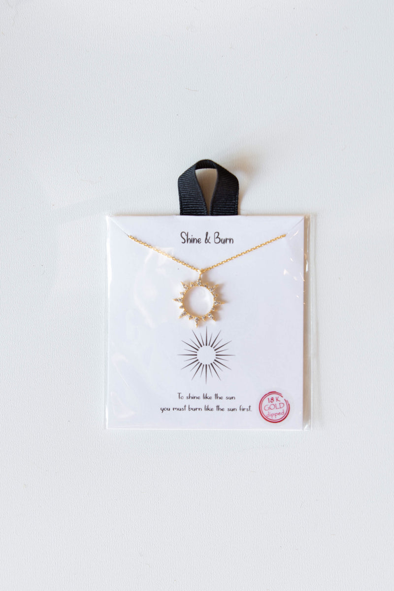 mode, shine & burn sunburst necklace