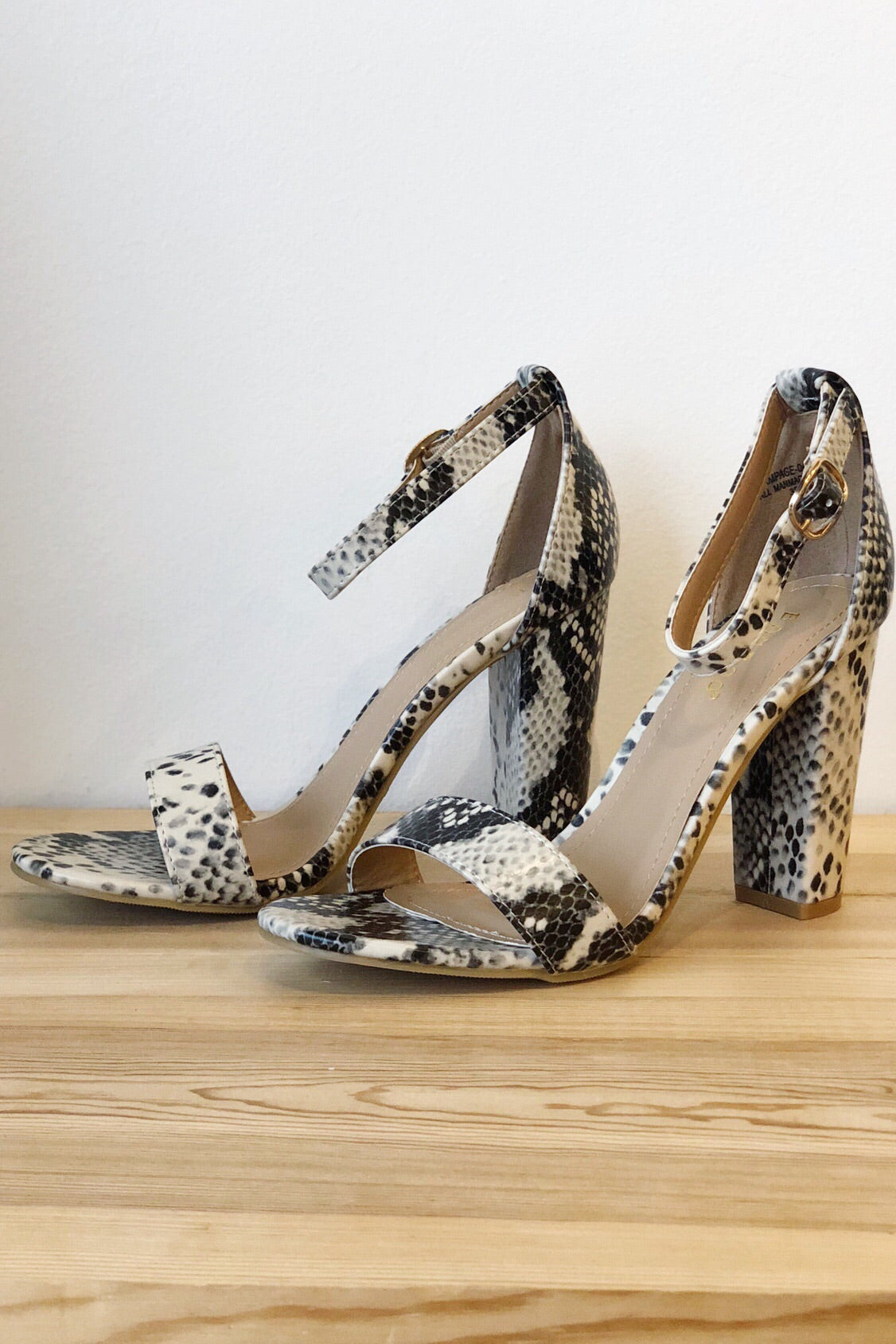 mode, up and out python heels