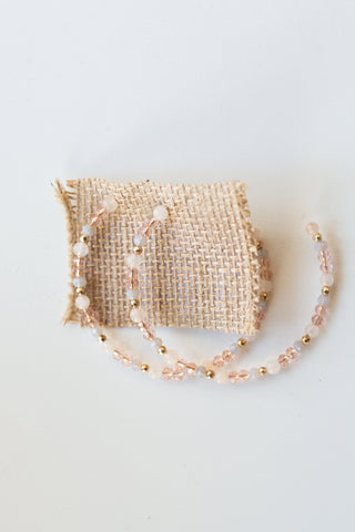 believe it round beaded bag