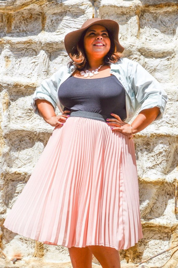3710fdcd9 A maxi pleated skirt in orange could be the symbol of spring and you can  wear it even if you are classic. Go neutral with a white top, a beige  jacket or ...