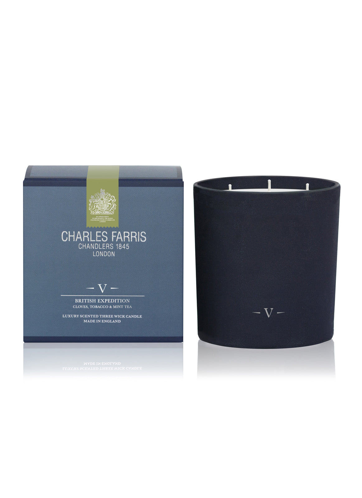 A 3-wick luxury scented candle in a dark blue jar.