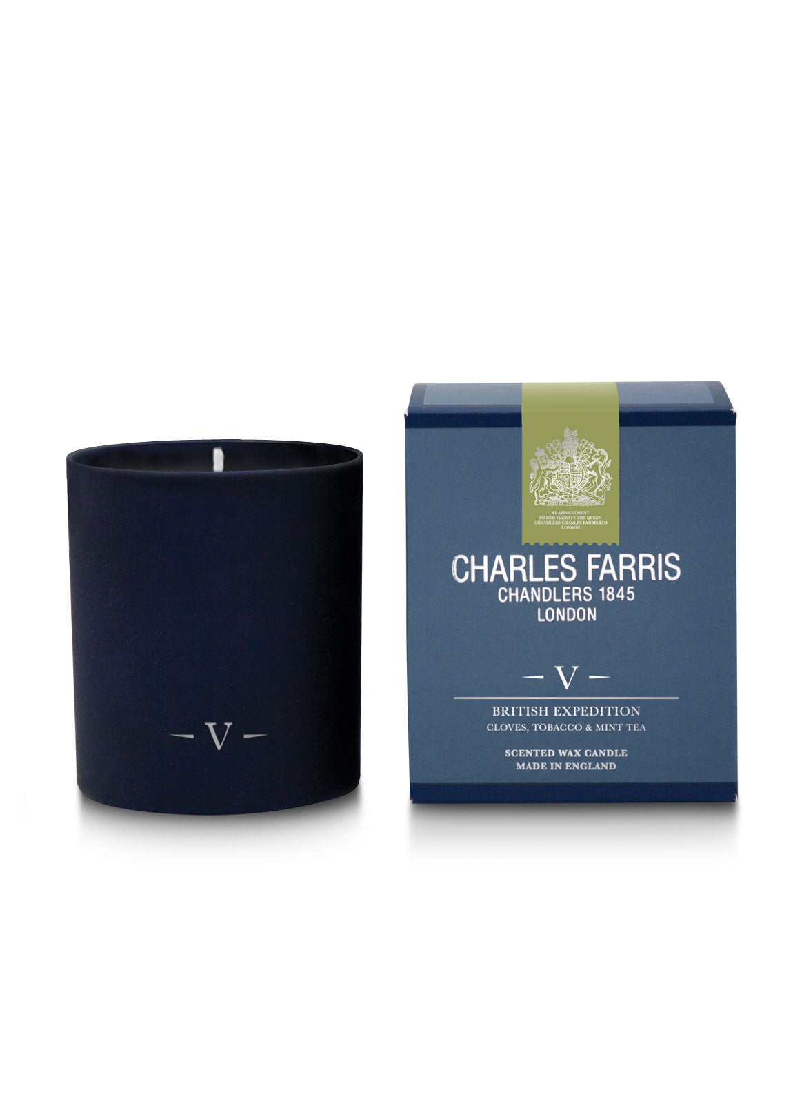 A luxury scented candle in a dark blue jar.