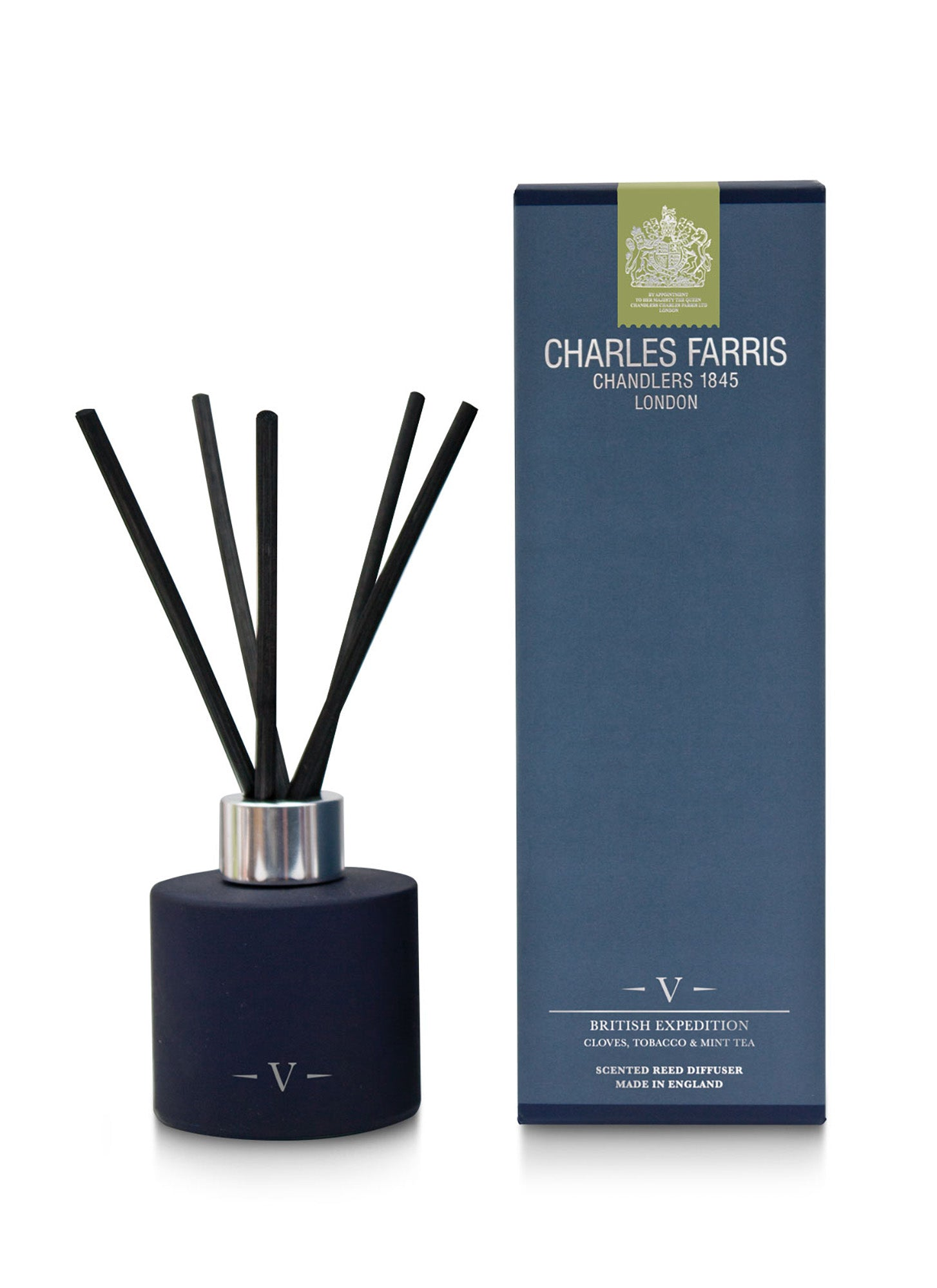 A reed diffuser with a dark blue jar.