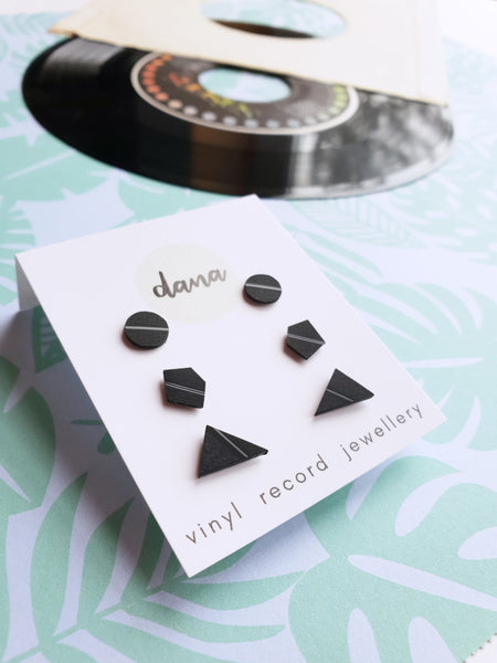 Set of three pairs of handmade flat black vinyl record stud earrings