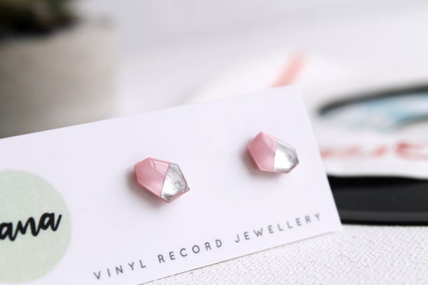 Contemporary geometric stud earrings in pink and silver made from vinyl record