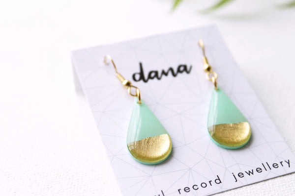 Contemporary gold dipped teardrop vinyl record earrings