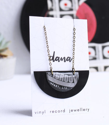 Groovy semicircle vinyl record necklace in black