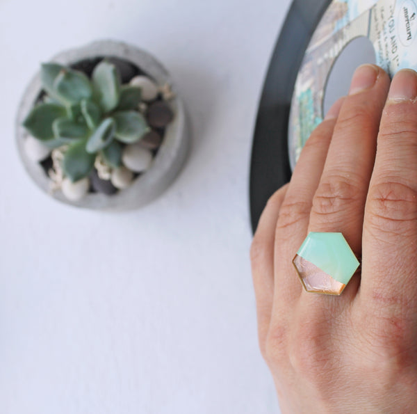 Hexagon ring in coppery rose gold and mint green made from a vinyl record!