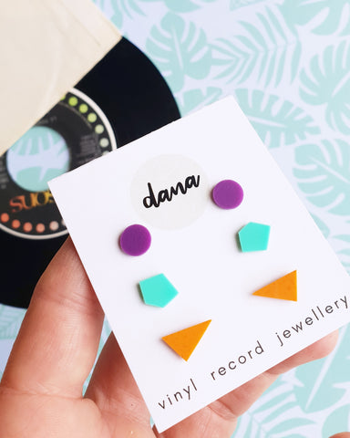 Set of three pairs of colorful flat black vinyl record stud earrings