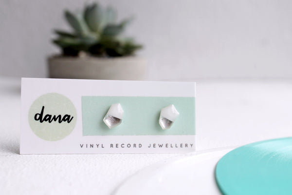 Simple vinyl record stud earrings in white and silver by DANA Jewellery