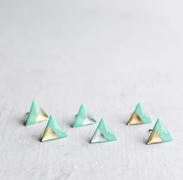 Contemporary metallic triangle stud earrings made from vinyl in minty green