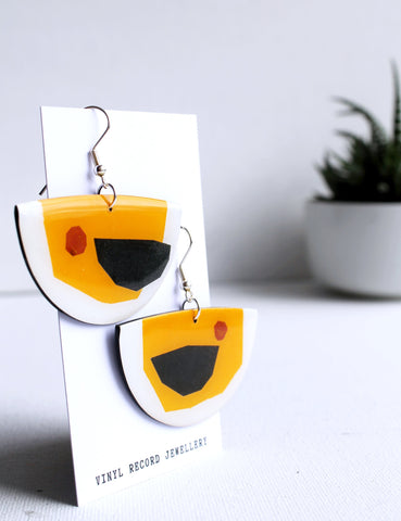Quirky one of a kind sustainable earrings handmade from recycled vinyl record