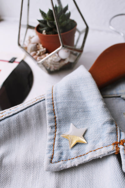 Gold dipped white star pin made from a vinyl record
