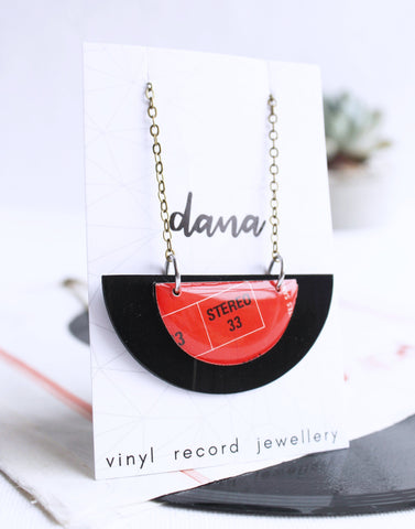 handcrafted semicircle upcycled vinyl record necklace in black and red