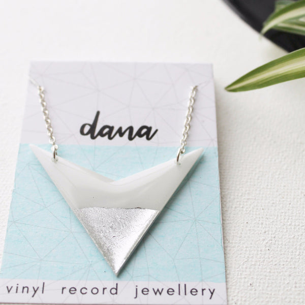 Bold white and silver vinyl record arrow necklace