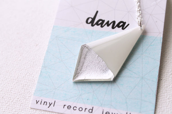 silver dipped geometric pendant necklace made from vinyl record