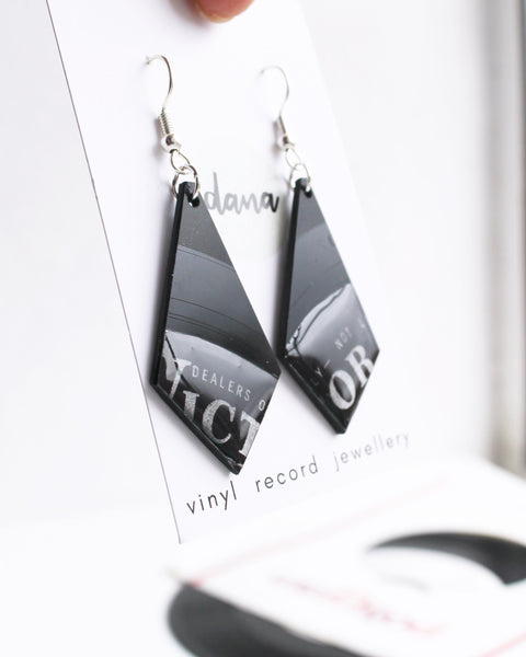 Long black earrings handmade from recycled vinyl record by Dana Jewellery