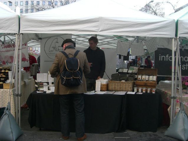 Serving a customer at the Tea and Coffee Festival, Southbank