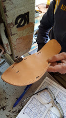 sandal sole being made by hand