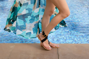 Pasha leather sandals in black and gold