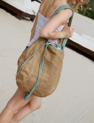 Besea beach bag with leather trim and straps over shoulder