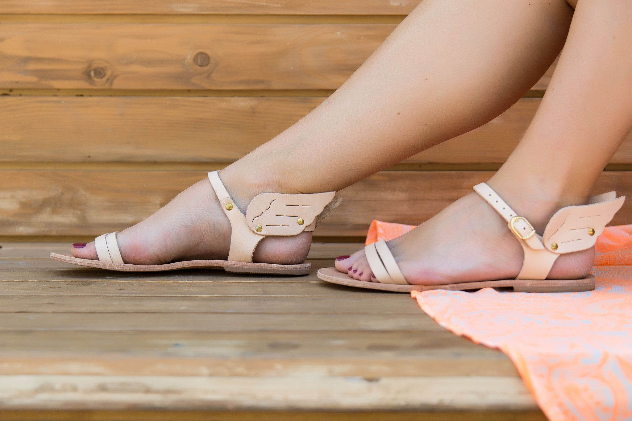 Ermes sandals with wing in nude leather