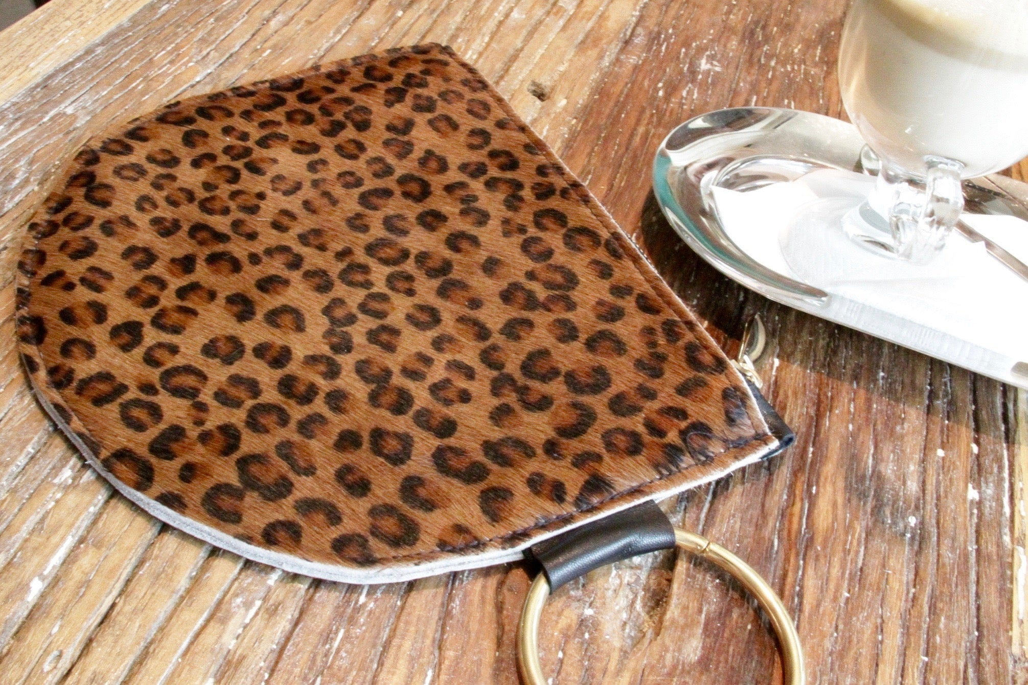 Leopard print pony leather clutch bag with hoop handle