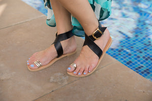 Pasha sandal in black and gold straps