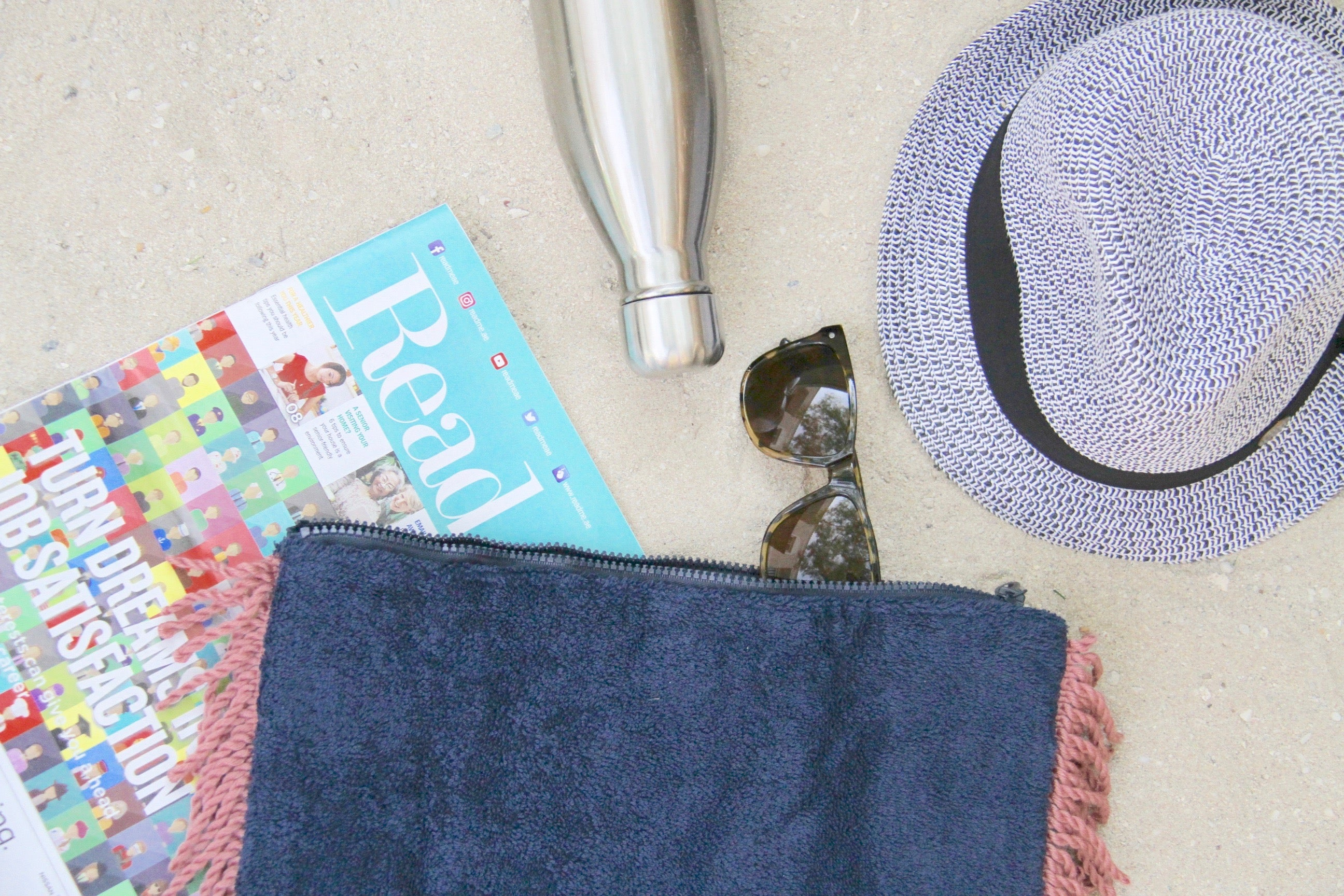 Beach Towel Clutch Bag in blue with pink