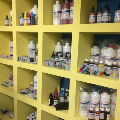 Ink refill bottles and refillable cartridges on the shelf at Premium Inks Louth computer shop.