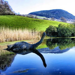 A sea monster in a lake with grass in the background