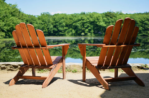 Two wooden chairs overlooking the beautiful lake