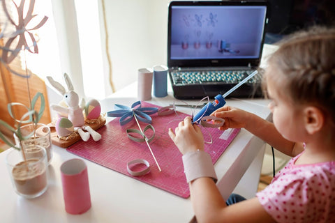 Child working on a hand crafted, personalized gift