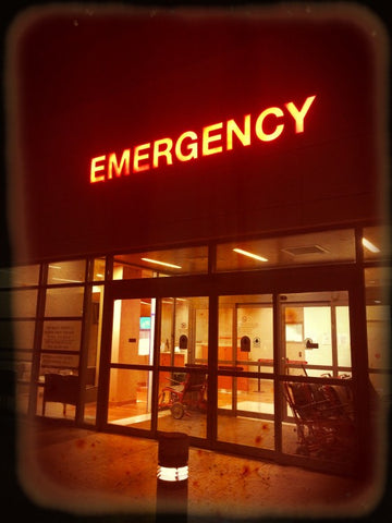 """Emergency building with lit up """"Emergency"""" sign"""