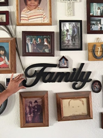 Family photos hung on wall